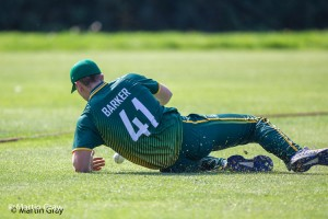 Lucas Barker slides to field on the boundary